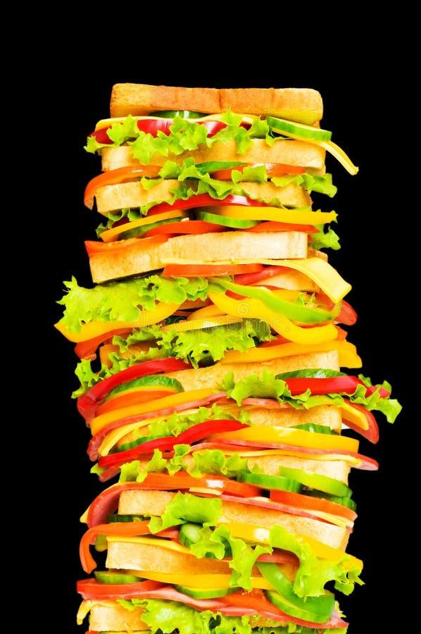 högväxt isolerad smörgås royaltyfri foto