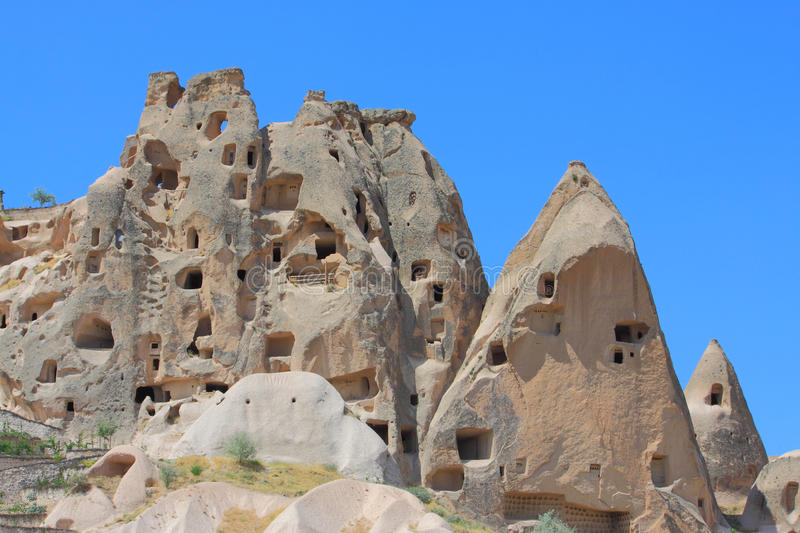 Höhlen in den spectalar Felsen, Cappadocia, die Türkei stockfoto