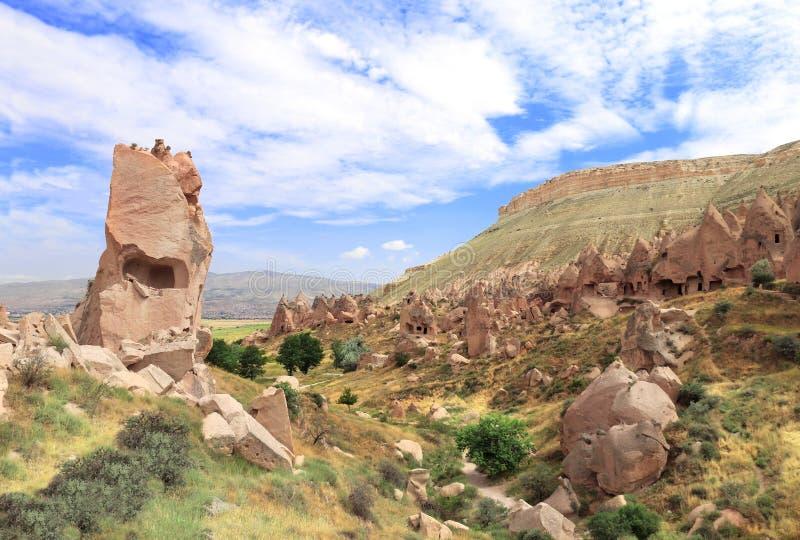 Höhlen im Felsen, Selime-Kloster, Ihlara-Tal, Cappadocia, die Türkei lizenzfreie stockfotografie