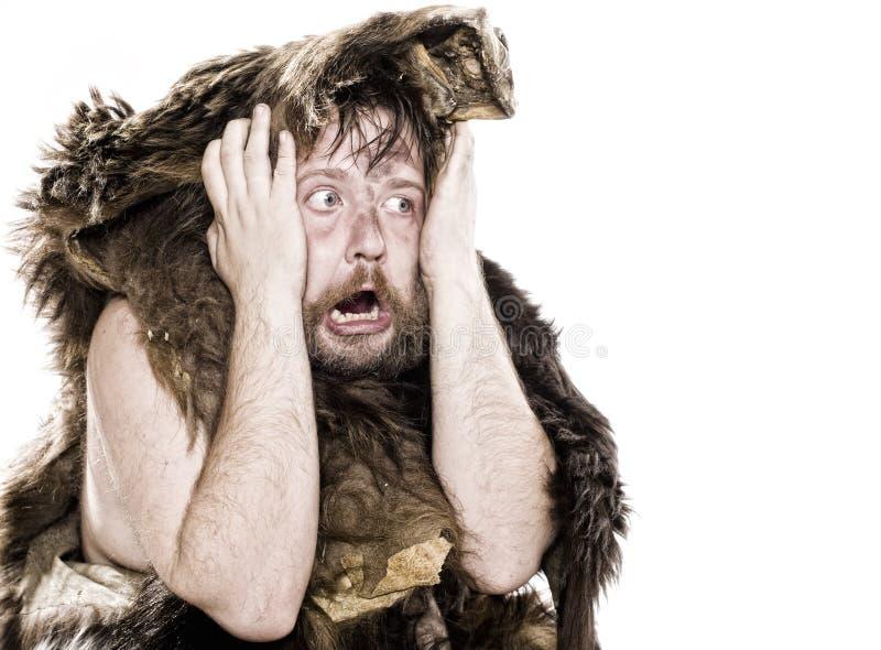 Höhlenbewohner in der Bärenhaut stockfotografie