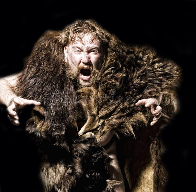 Höhlenbewohner in der Bärenhaut lizenzfreies stockbild