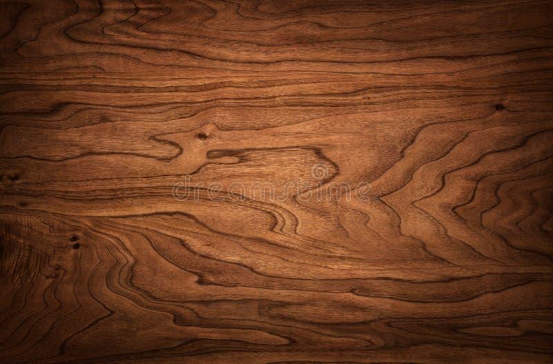 Hölzerne Beschaffenheit der natürlichen dunklen Walnuss stockfoto