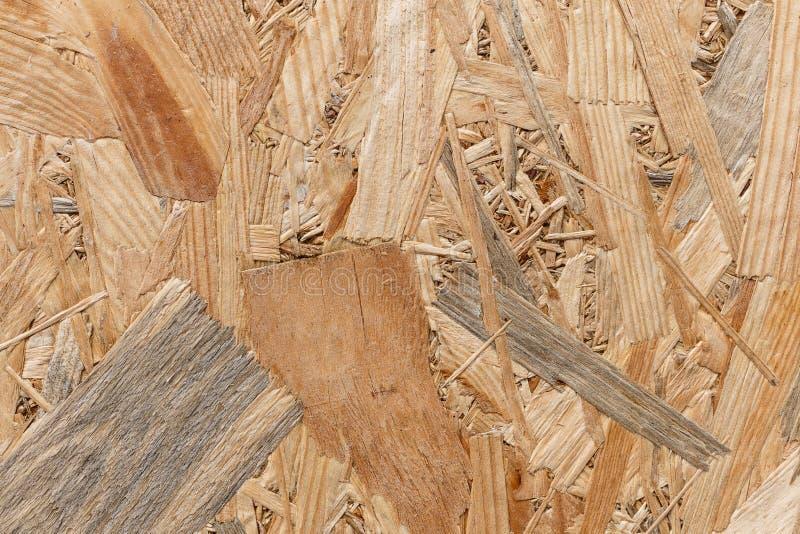 Hölzerne Beschaffenheit mit natürlichem Muster Sperrholzbeschaffenheit mit Kratzern für Hintergrund und Design OSB - Gedrängte Ho stockfotos