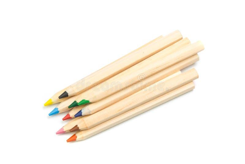 Hölzerne bunte gewöhnliche Bleistifte lokalisiert auf einem weißen Hintergrund, Bild stockfotografie