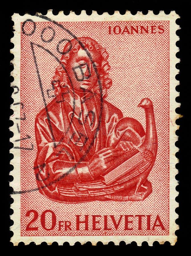 Hölzerne Carvings des Evangelisten John mit dem Adler stockfotos