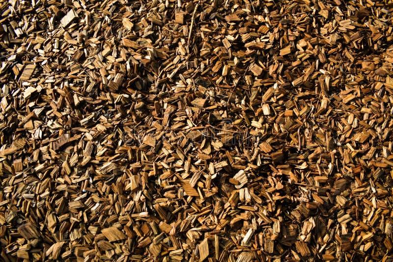 Hölzerne Chips Flakes Chunks Pieces Brown-Goldsonnenschein-Dekoration P lizenzfreie stockfotos