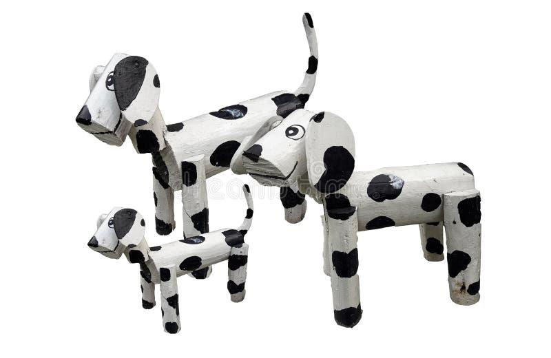 H?lzerne Hundefamilienstellung lokalisiert auf wei?em backgtound stockbilder