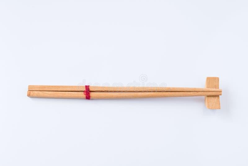 Hölzerne japanische chinesische asiatische Bambusart des Essstäbchens auf weißem Hintergrund lizenzfreies stockfoto