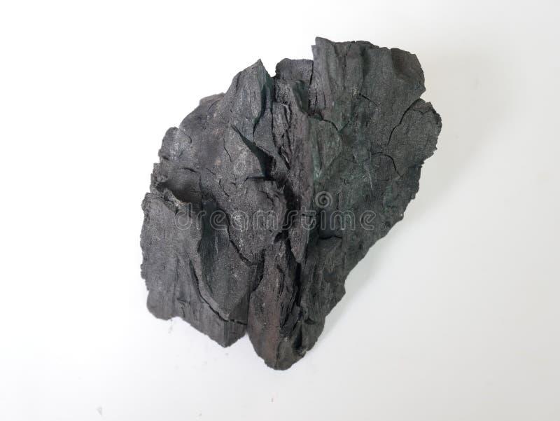 Hölzerne Kohle lokalisierter weißer Hintergrund stockfotografie