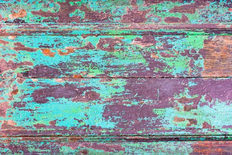 Hölzerne Planken des abstrakten Schmutzes masern Hintergrund mit abgezogener blauer Farbe stockbild