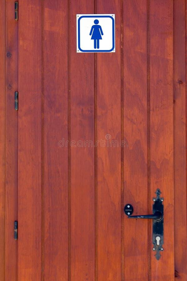 Hölzerne Tür der Dametoilette stock abbildung