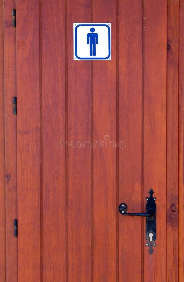 Hölzerne Tür der Menstoilette stock abbildung