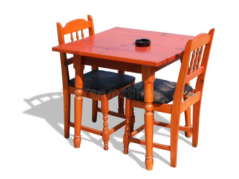 Hölzerne Tabelle und Stühle stockfoto