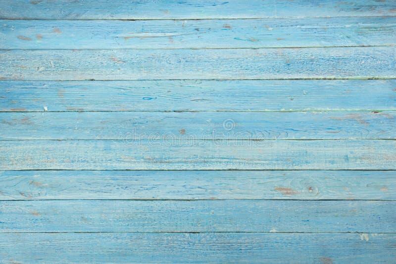 Hölzerner Beschaffenheitshintergrund Hartholz, hölzernes Korn, Schmutzart des organischen Materials Draufsicht der blauen Holzobe lizenzfreie stockfotos