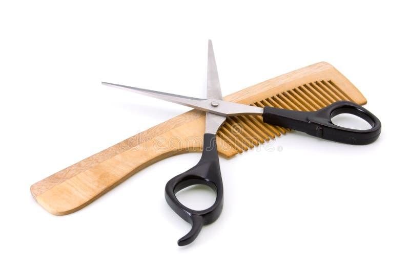 Hölzerner Hairbrush und Scheren stockbild