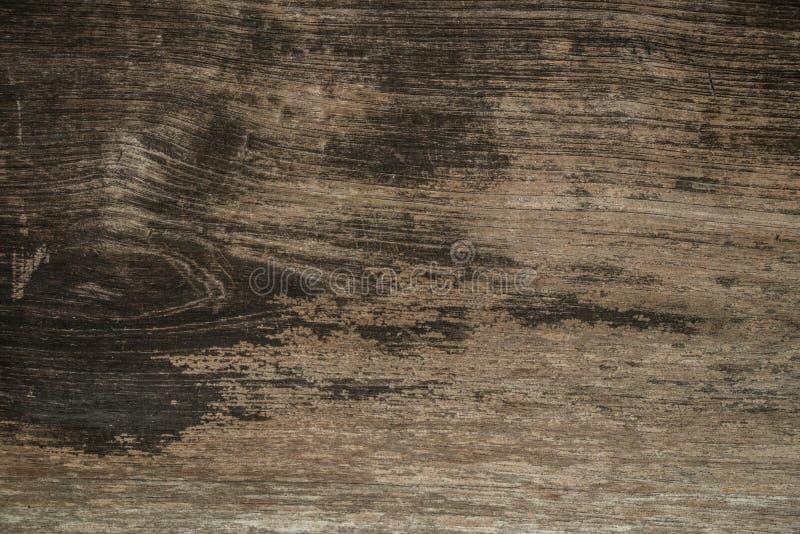 Hölzerner Hintergrund Altes braunes Holz mit Wolldecke und Fleck auf Holzoberfläche à ¹ ƒ lizenzfreies stockfoto