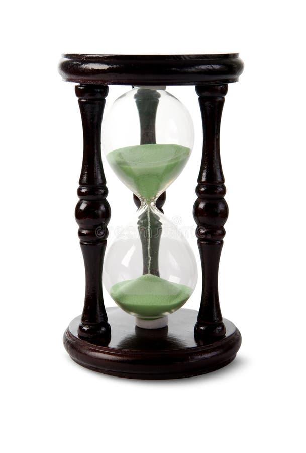 Hölzerner Hour-glass mit grünem Sand. lizenzfreies stockbild
