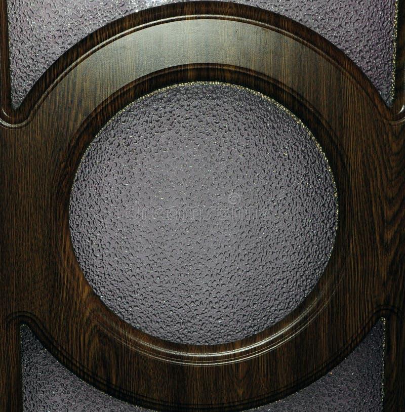 Hölzerner Kreis Browns auf einer Glasoberfläche lizenzfreie stockfotos
