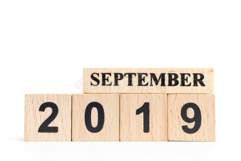 Hölzerner Würfelkalender im September 2019 lizenzfreie stockfotos