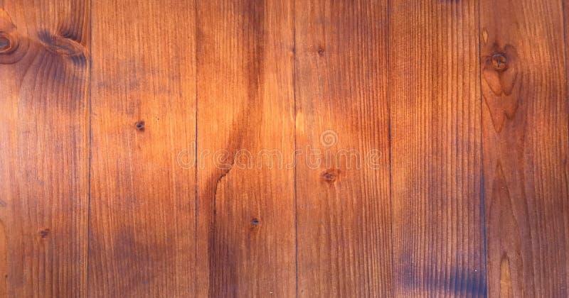 Hölzernes braunes Korngefüge, dunkler Wandhintergrund, Draufsicht des Holztischs stockbilder
