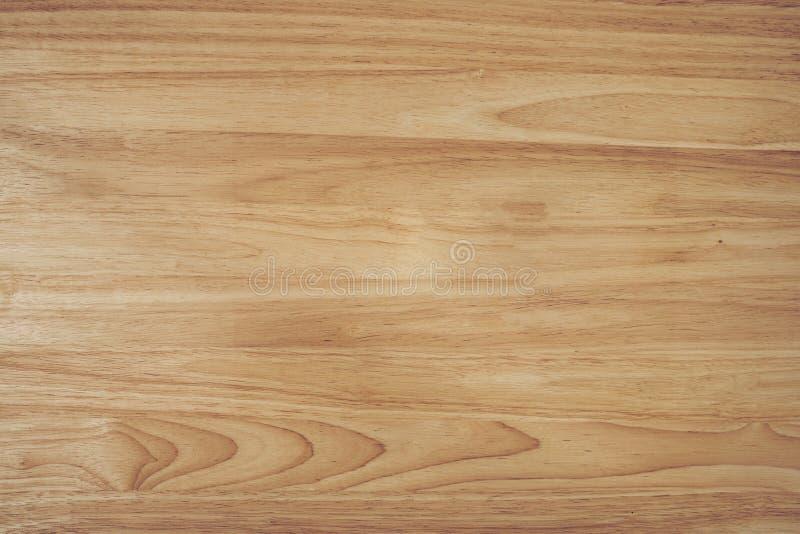 Hölzernes braunes Korngefüge, dunkler Wandhintergrund, Draufsicht des Holztischs mit Kopienraum lizenzfreie stockfotos