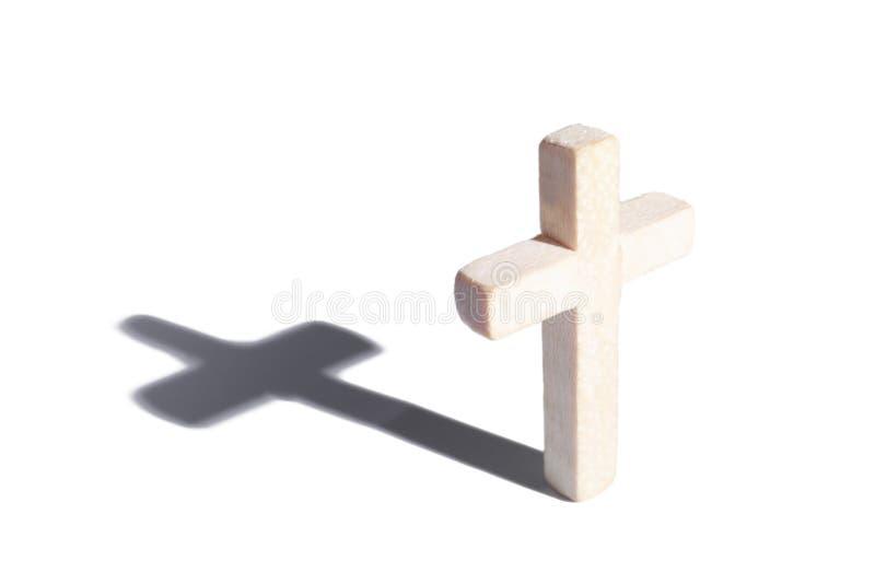 Hölzernes Kreuz mit Schatten stockfotografie