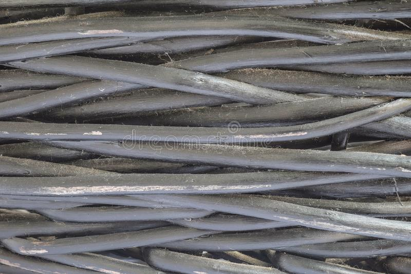 Hölzernes Oberflächenmuster der Nahaufnahme am alten und schmutzigen Schwarzen malte hölzernen Webartkorb-Beschaffenheitshintergr lizenzfreies stockfoto