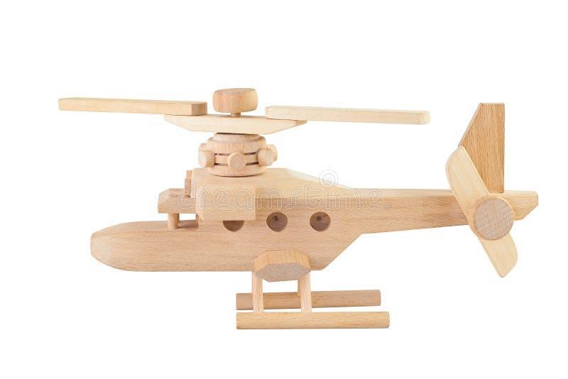 Hölzernes Spielzeug des Hubschraubers getrennt lizenzfreies stockfoto