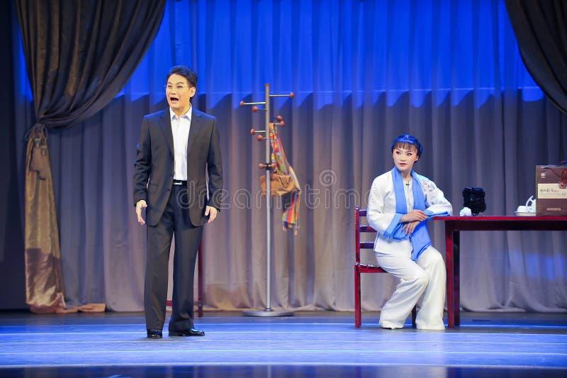 Hören auf seinen Mantel Geschichtejiangxis OperaBlue stockfoto