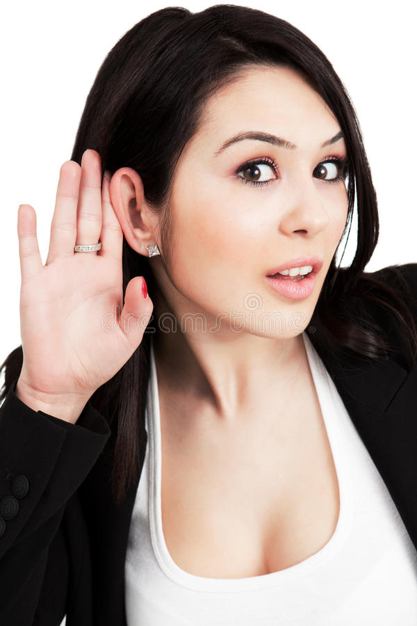 Hören Konzept - eine neugierige Frau lizenzfreie stockfotos