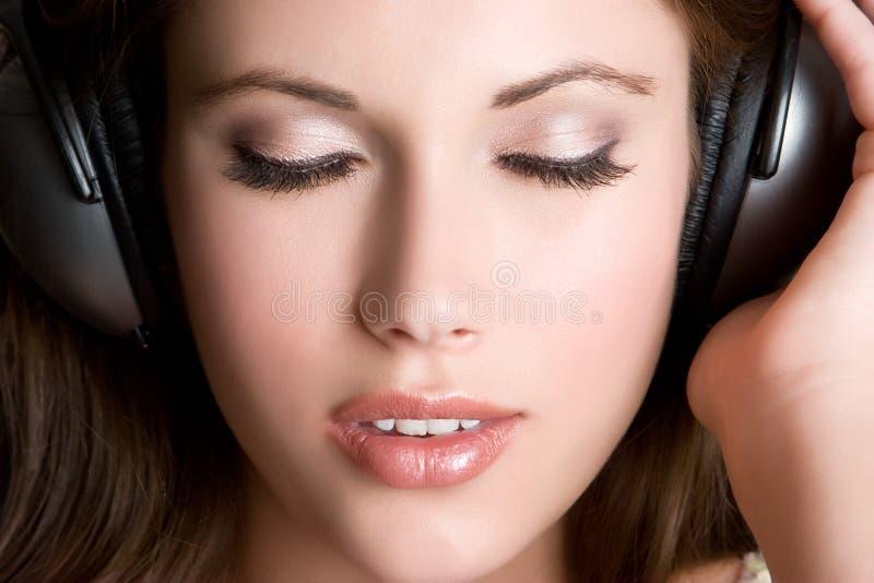 Hören Musik stockbild