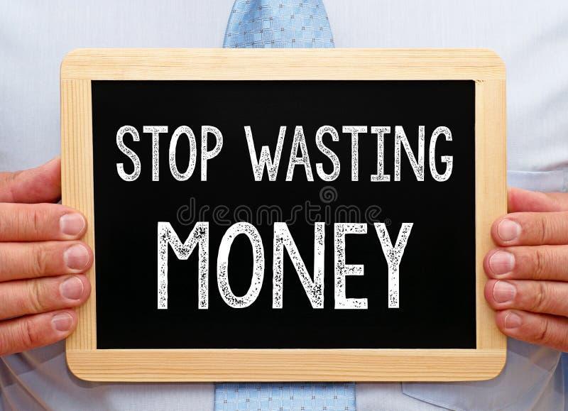 Hören Sie auf, geld- Manager mit Tafel zu vergeuden lizenzfreie stockfotos