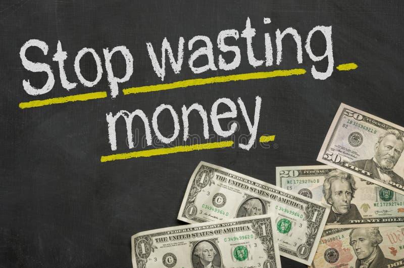 Hören Sie auf, Geld zu vergeuden lizenzfreies stockbild