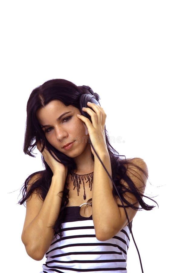 Hörende Musik des jungen Mädchens lizenzfreie stockfotos