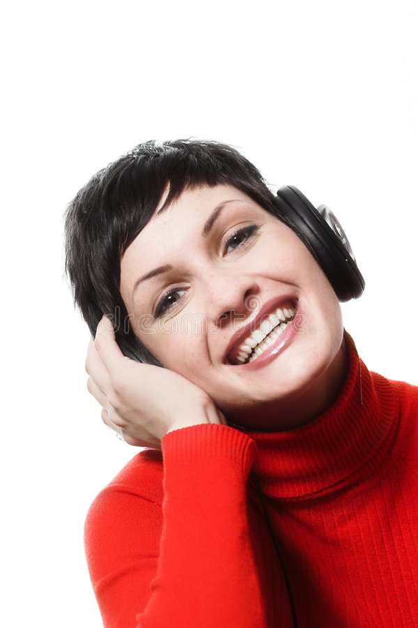 Hörende Musik von den Kopfhörern lizenzfreies stockbild