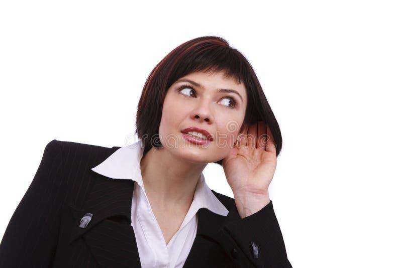 Hörender Klatsch der Geschäftsfrau stockbilder