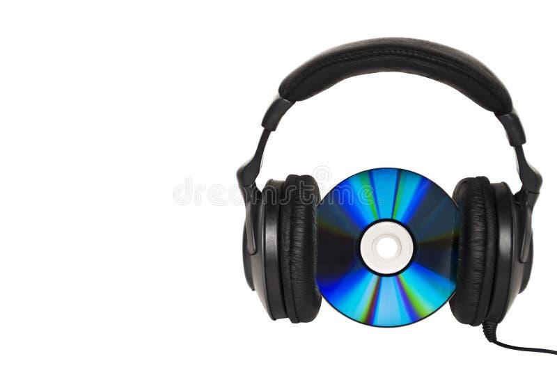 Hörlurar med CD - musikbegrepp arkivbilder