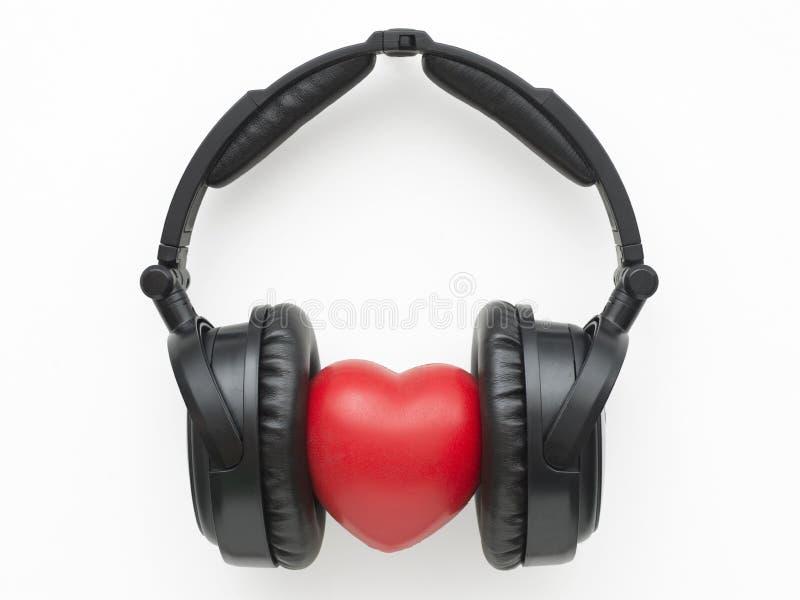 Hörlurar med hjärta arkivfoto