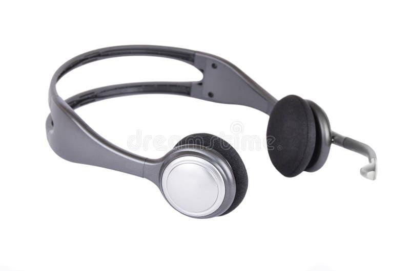 Hörlurar med mikrofonen arkivfoto
