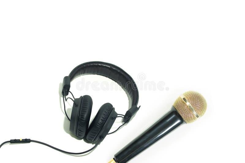 Hörlurar med mikrofonen på whitbakgrund arkivbild