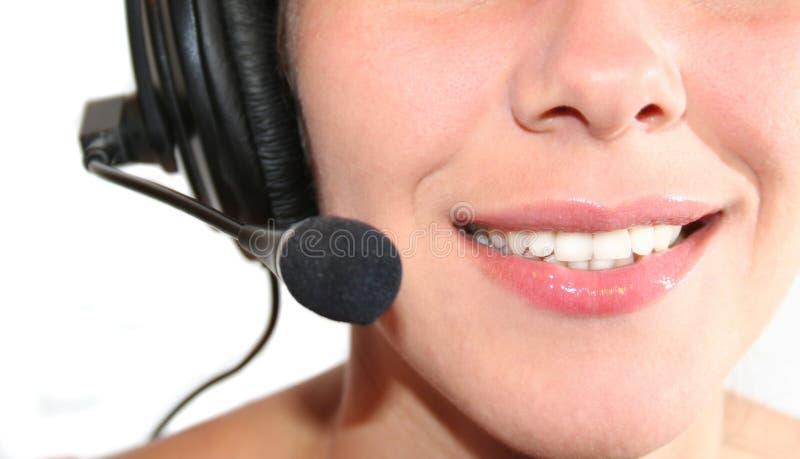 hörlurar med mikrofonkvinna royaltyfri fotografi