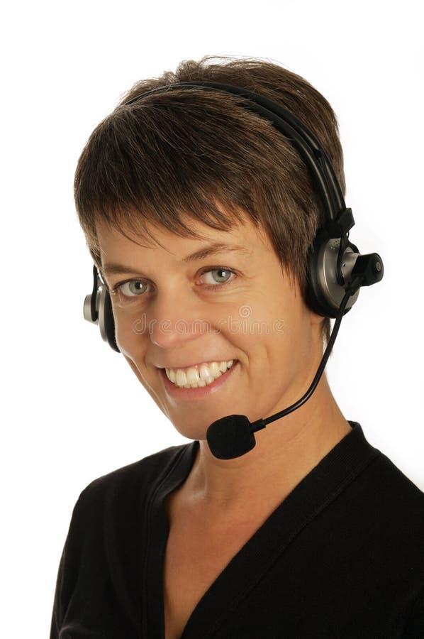 hörlurar med mikrofonkvinnor royaltyfri foto