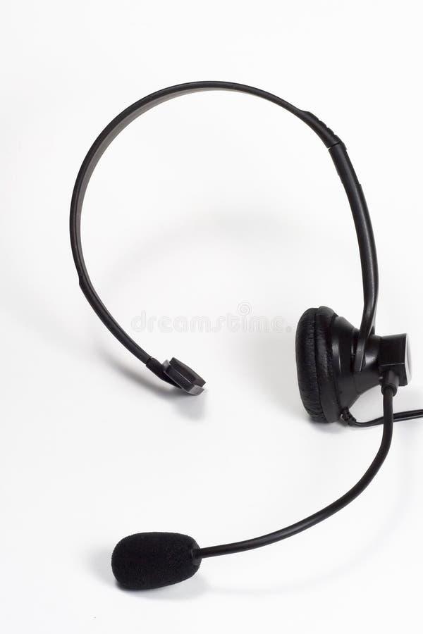 hörlurar med mikrofontelefon arkivfoton