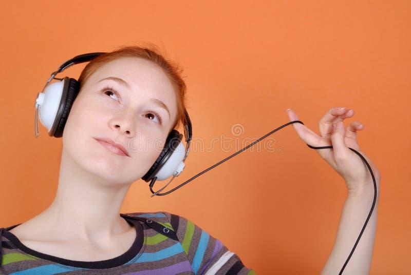 hörlurarkvinna fotografering för bildbyråer