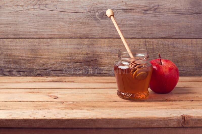 Höstbakgrund med honung och äpplet arkivbilder
