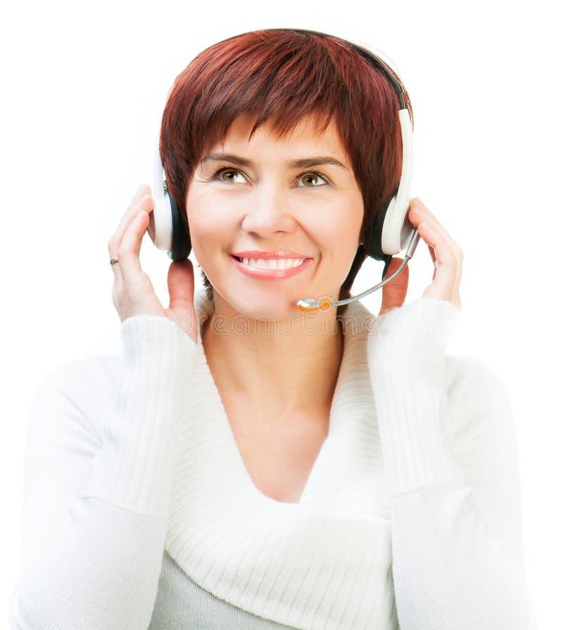 Hübsche Frau in einem Kopfhörer lizenzfreie stockbilder