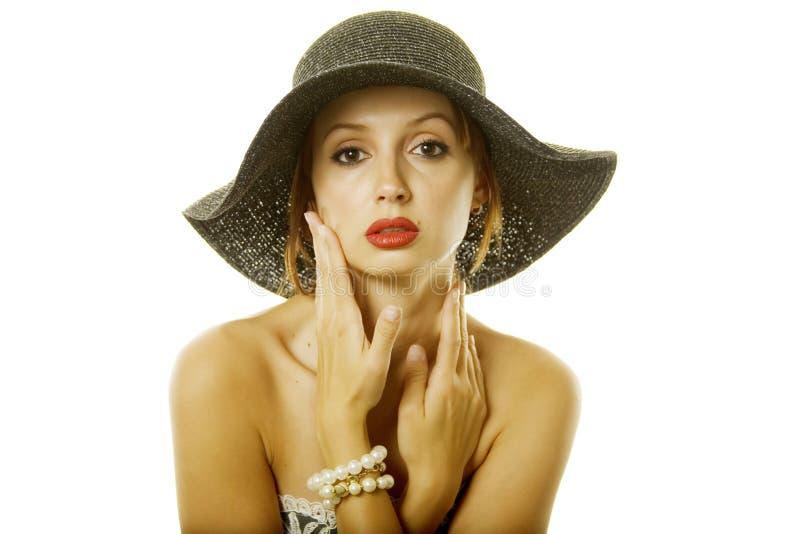 Hübsche Frau im Hut stockbild