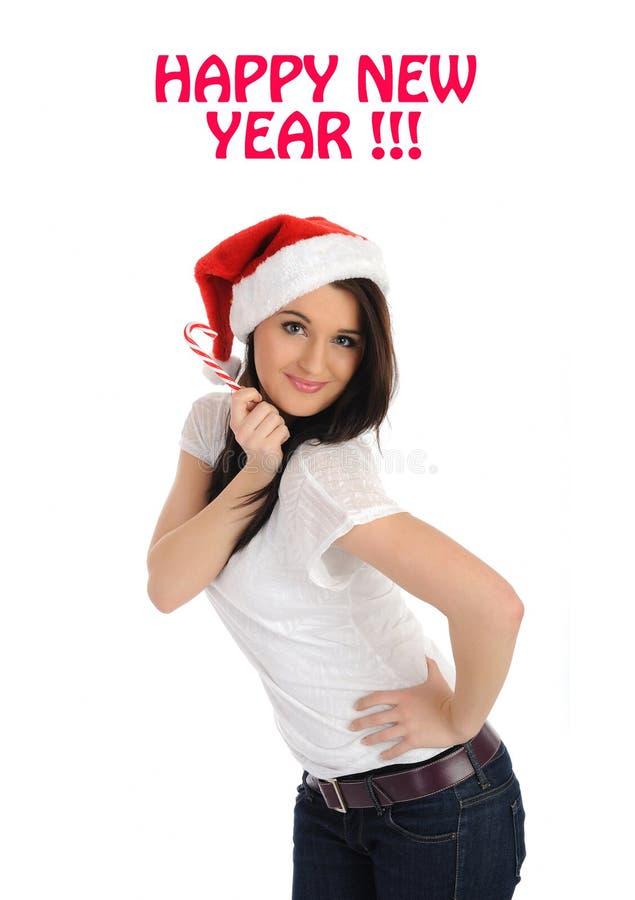 Hübsche Frau im roten Weihnachtshut, der einen Wunsch bildet lizenzfreie stockbilder