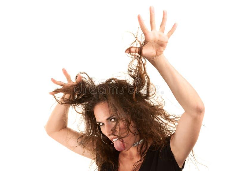 Hübsche Frau mit dem wilden Haar lizenzfreie stockbilder