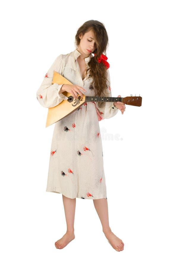 Hübsche Frau mit einem Volksinstrument stockbild
